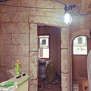寝室/レンガ/薪ストーブ/暖炉/アンティーク/モルタル造形…などのインテリア実例