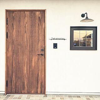 男性の、、の「玄関/入り口」についてのインテリア実例