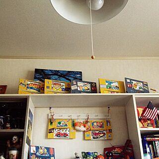 女性50歳の家族暮らし2DK、ガレージ風ポスターに関するMalamaさんの実例写真